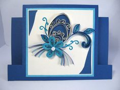 Beautiful Handmade Easter Greeting Card.    Blue Cardstock, blue quilled egg and quilled flowers.    ♦ Folded quilling card.    ♦ Designed to sit