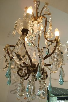 Vintage crystal chandelier with blue drops. Want this personally and would want to sell it in the Store as well!