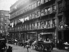 """Shorpy Historical Photo Archive : Elizabeth Street: 1912 """"Row of tenements, 260 to 268 Elizabeth St., New York, in which a great deal of finishing of clothes is carried on. Us History, American History, Old Pictures, Old Photos, Antique Pictures, Vintage Photographs, Vintage Photos, Lewis Hine, Elizabeth Street"""