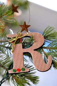 embellish your plain monogram ornament with a cute red & white striped fabric and buttons for the Christmas tree or would make an excellent gift tag