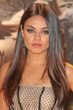Brown Hair Color - Rich chocolaty hair? Yes ma'am! Mila Kunis's rich brown hair color is a perfect option for those looking for a natural, stunning makeover.