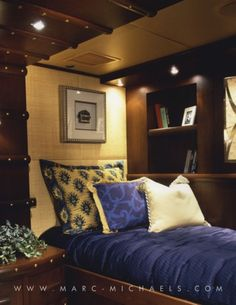 Yacht bedroom, built in bookshelf, Mia Elise - Bossy Boots - 136' Intermarine | Marc-Michaels Interior Design, Inc.