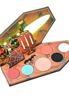 Lunatick Cosmetic Labs Elvira Palette will have yew lookin' like the fiercest mistress of the dark, babe. This dope af palette features a sikk coffin shape and opens to reveal six eyeshadow colors that are perfect fer creating endless eye looks and keepin yer peeperz lookin' mesmerizingly gorgeous.