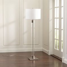 An illuminating mix of modern and metal, our tall floor lamp rises high on a cylinder of clear glass, capped with silvery nickel accents. A crisp white drum shade adds to the lamp& clean, light look. Diy Floor Lamp, Tall Floor Lamps, Silver Floor Lamp, Adjustable Floor Lamp, Pipe Lamp, Drum Shade, Crate And Barrel, Shabby Chic, Flooring