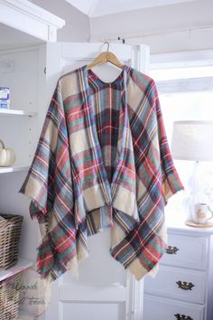 Get ready for pumpkin picking with this superbly easy clothing refashion, turning a shawl into a poncho!