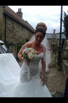 Chloe looking stunning in her wedding gown by Alexia Designs carrying 1920 style vintage bouquet in fresh flowers with pearls and diamanté.
