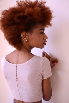 Pretty in pink...red. Natural Hair. I try not to criticize too often, but that necklace concerns me a little. Some fool grabbing you from behind?! Natural hair styles for african american black women http://www.shorthaircutsforblackwomen.com/coconut-oil-for-hair/