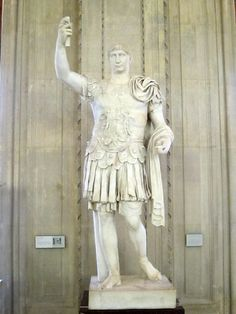 Emperor Trajan in the traditional militaristic pose.  The head looks small -- probably the result of ancient artists re-using existing statues and re-cutting them to resemble the current leader.