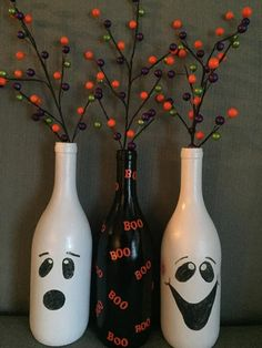 Halloween ghost wine bottles Three hand painted wine bottles with fun colorful branches! These bottles are an adorable decoration for the holiday season. Halloween Wine Bottles, Liquor Bottle Crafts, Christmas Wine Bottles, Crafts With Bottles, Fall Wine Bottles, Empty Wine Bottles, Wine Bottles Decor, Wine Jug Crafts, Crafts With Wine Bottles