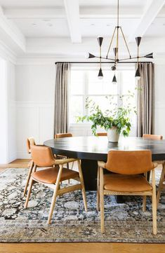 Gorgeous round dining room table and love the leather chairs – Amber Interiors Dining Room Design, Dining Room Table, Dining Room Industrial, Dining Room Chandelier, Dining Room Inspiration, Dining Chairs, Mid Century Modern Dining Room, Round Dining, Modern Dining Room