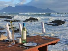 Isn't this paradise? Bloubegstrand is only a stones' throw from Cape Town city and enjoying lunch with such a view is stunning. Best Places To Eat, Great Places, Beautiful Places, Crashing Waves, Cape Town, The Rock, Touring, South Africa, The Good Place