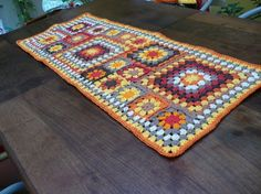 granny square table runner.   I love the colors and the combination of different size squares