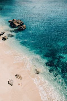 Bucket list inspiration, sunbathing on a secluded beach in Bali!