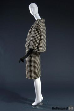 Courrèges - France 1961 Charcoal and white houndstooth wool; suede. From Courrèges' first collection, reflects the couturier's training at Balenciaga.
