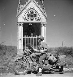L/Cpl. Donald Mayford 'Don' Fife of Provost Company, Canadian Provost Corps on his Norton parked by the shrine on the just outside of Fresney-le-Puceau, Lower Normandy, en route to Falaise on August 12 Cycle Pictures, Ww2 Pictures, Ww2 Photos, Canadian Soldiers, Canadian Army, Canadian History, British Army, British Motorcycles, Old Motorcycles