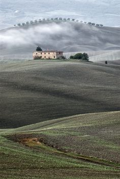 Misty sunrise over Pienza – Val d'Orcia, Province of Siena, Tuscany region Italy