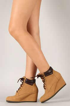 Complete your casual look with these fashionable wedge sneakers. Featuring round toe, stitching accents, lace up front closure, and wedge heel. Finished with cushioned insole, padded collar, and tongue for your comfort.
