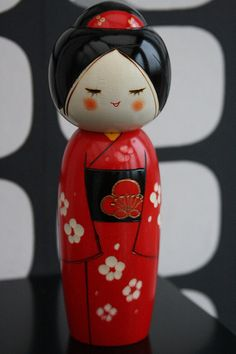 Red and black lacquer Kokeshi