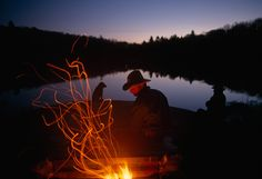 Men and Dogs Sit by a Campfire in New York's Adirondack Mountains, December 1998.