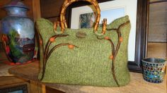 Hand knitted felted bag with needle felted design