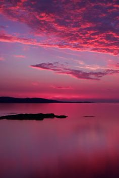 Sunset background of pink skies over the ocean at Loch Ewe in Scotland