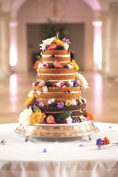 Undressed cakes are delectable if you add fruit and flowers – this design by Daisy Cakes features a tier of different flavoured sponges. More at http://absolutely-weddings.co.uk/style-statement-wedding-cakes/