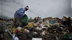 A catador, or scavenger, picks through trash at Jardim Gramacho, a massive landfill in Rio de Janeiro, Brazil. The three-decades old landfil...