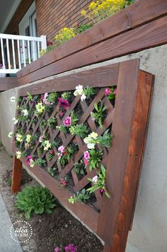 vertical-flower-garden could do something like this in an empty spot if their is one ;)