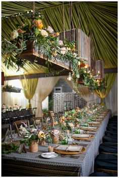 Stunning tabletop with suspended floral chandeliers in wooden boxes, wooden pendant lights, chevron linens, green glassware and rattan chargers. Florals, draping, decor, linens and pendant lights by Blossoms Events, image by Carmen Ash Photography at Brookgreen Gardens in Murrells Inlet, SC.