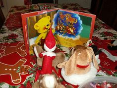Reading a Christmas book with his friends.