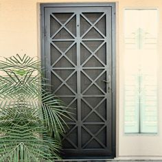 Custom wrought iron security screen doors, or storm doors, of the highest quality. Contact First Impression Ironworks today for an in-home appointment Metal Screen Doors, Front Door With Screen, Wooden Screen Door, Iron Doors, Front Entry, Wrought Iron Security Doors, Steel Security Doors, Security Screen Doors, Window Grill Design