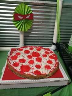 Teenage Mutant Ninja Turtles cookie cake decorated like a pizza. TMNT birthday party.