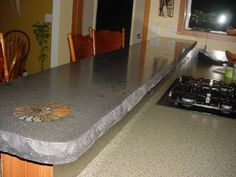 Natural Color Concrete Counter With Shell Inlay And Rough Edges. Think  Polished Bar Surface