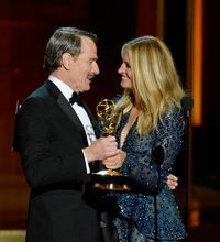 Julia Roberts presents Bryan Cranston the outstanding lead actor in a drama series Emmy for 'Breaking Bad' during the Emmy Awards.