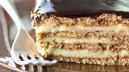 Here is one of my all-time favorite desserts: It looks and tastes like a dessert casserole, but it spends no time whatsoever in the oven. It is an icebox cake composed of layers of graham crackers and fresh, homemade vanilla pudding, topped with fudge frosting. When it sits together in the fridge overnight, it melds into a luxurious cake-like texture.