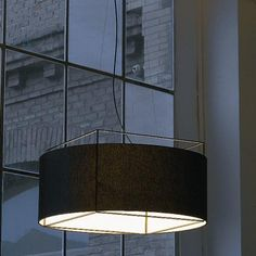 A translucent linen drum shade encircles a metal cube shaped frame. http://www.ylighting.com/hin-lewit2930.html