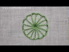 I ❤ embroidery . . . Buttonhole Wheel or Circle~ You can work buttonhole wheels with radiating spokes from a center point. You can also work the buttonhole wheel around a center dot, to create a flower or other similar element. The trickiest part of working a buttonhole wheel is keeping the stitches from closing up on you as go around the circle.