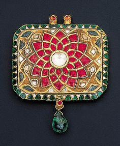 North India | Tawiz pendant; decorated to the front with a foiled rock-crystal flower with a diamond centre to the green and white enamelled border suspending an emerald bead, the reverse similarly enamelled with a large red flower within green foliage | ca. late 18th to early 19th century | 5,750£ ~ Sold Oct '99