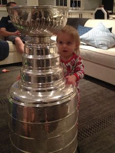 Patrick Sharp's little girl Madelyn is in awe of her shiny new friend.
