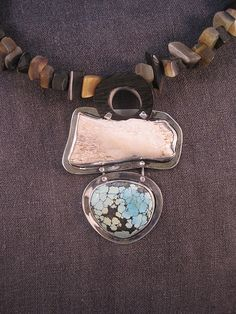 Back in the Saddle Again by e-bu Jewelry: Materials: Sterling Silver, Turquoise, Bone Fragment, Horn Wedges.     $395.00