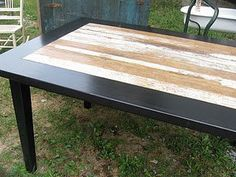 A table that use to have old tile in it refurbished with old barn wood.