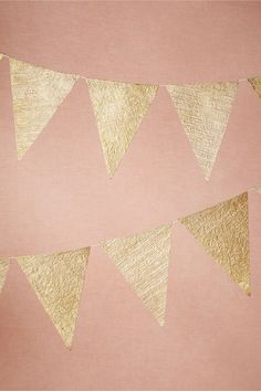 Golden Age Pennants from BHLDN - We can make this ourselves too on black & white baker's twine.