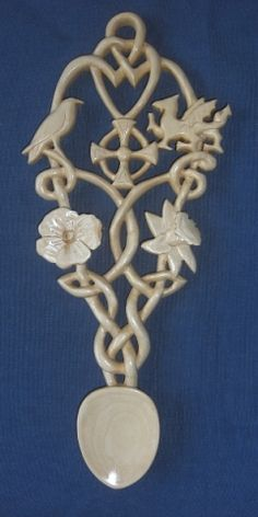 A Celtic Love spoon with a crow, dragon, poppy and daffodil. #Lovespoons