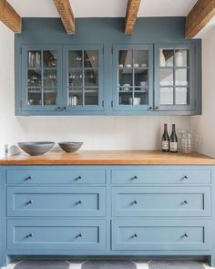 13 New Kitchen Trends - light blue cabinets, butcher block countertop, exposed beams, glass front cabinets - interno & esterno Farmhouse Kitchen Cabinets, Modern Farmhouse Kitchens, Kitchen Cabinet Design, Cool Kitchens, Rustic Farmhouse, Kitchen With Blue Cabinets, Kitchen Modern, Colorful Kitchens, Kitchen Cabinetry