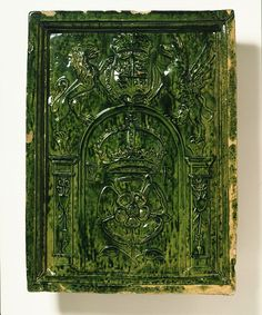 Tile      Place of origin:    Surrey, England (possibly)      Hampshire, England (possibly)      Date:   ca. 1550      Artist/Maker: Unknown      Materials and Techniques:      Moulded red earthenware, with lead glaze stained green with copper oxide - V & A