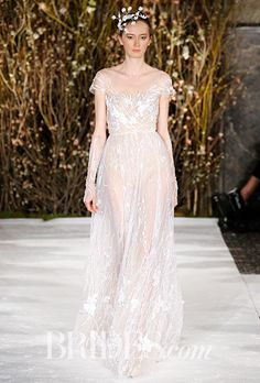"""Brides.com: . Ok, 2017 brides, it's time to get serious! If you're looking for ethereal and feminine on your wedding day, look no further than Israeli wedding dress designer Mira Zwillinger. The designer showed her Spring 2017 collection at Bridal Fashion Week today, and the dreamy wedding dresses are like something out of A Midsummer Night's Dream.  Following up last year's gorgeous """"Stardust"""" collection, Mira and Lihi Zwillinger, the mother-daughter design duo behind Mira Zwillinger…"""