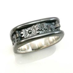 SteamPunk nuts and bolts wedding band for men. Daniel wants something like this for his wedding ring.