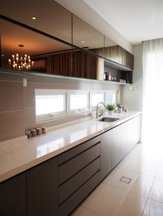Simple yet modern kitchen design by Sachi Interior Design