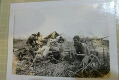 """My father and some of his Vietnam War buddies.  He's in the middle with the helmet and the gun.  My dad is the Veteran writer of Beneath the Bamboo: A Vietnam War Story.  Learn more here: http://www.jonathon-jones.com/beneaththebamboo.html    Keywords: vietnamwar veterans vietnamvets vets military soldiers 1stcav 1stcavalry firstcavalry firstcav army soldiers military militaryphotos 60s 1960s """"vietnam war"""""""