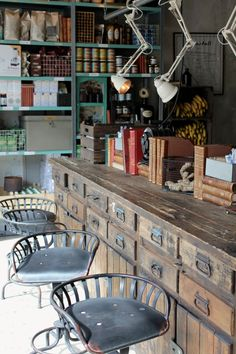 look at old industrial sets of drawers for 1) freestanding sink, and 2) on wheels as a trolley for crockery and cutlery storage, can roll away under concrete benchtop.